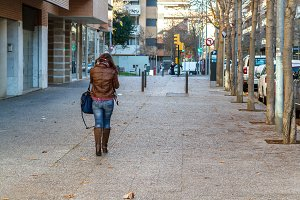 Girl walking alone down the street