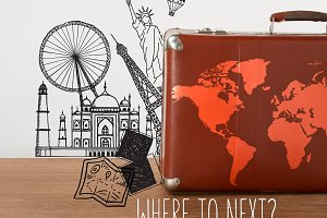 Brown vintage suitcase with map and