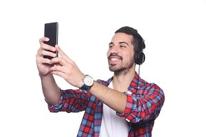 Young man taking a selfie with his s