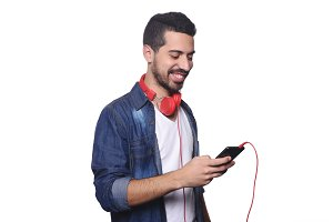 Young latin man with headphones and