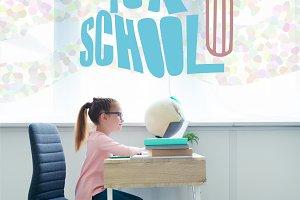 little schoolgirl studying with book