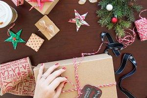 Hand wrapping Christmas presents