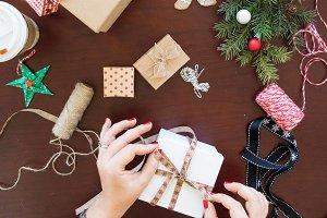 Woman's hand wrapping Christmas gift