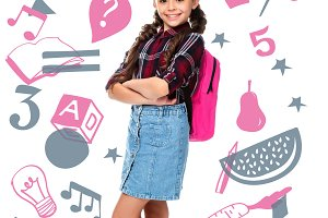 schoolchild with pink backpack stand
