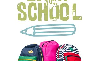 three colored schoolbags and wooden