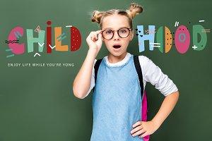 shocked schoolchild touching glasses