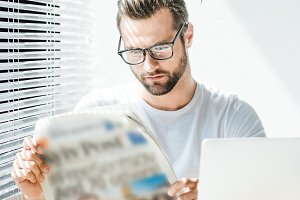 handsome businessman reading newspap