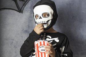 Little kid in a skeleton costume