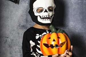 Young boy in the Skeleton costume