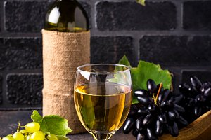 Grape, bottle and glass of white