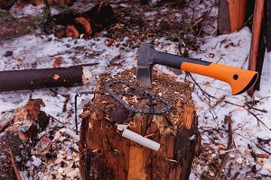 Ax and chain saw. Wood Stump. Top.