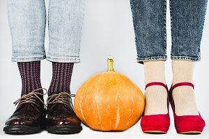 Ripe pumpkins and legs of a young