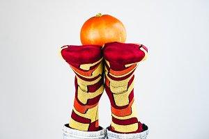 Ripe pumpkin, men's legs and funny