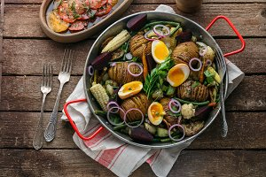 Hasselback potatoes with vegetables