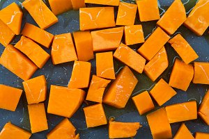 Chopped pumpkin drizzled with oil