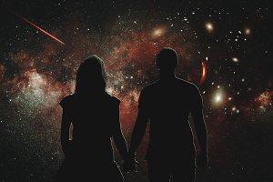 Amazing night sky and love couple.