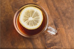 Top view of black tea with lemon on