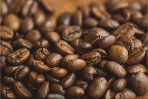 Brown coffee beans, closeup of macro