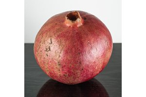 half ripe pomegranate fruit