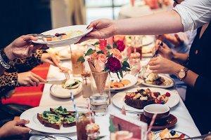 Waiter serve the clients table