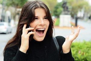 Portrait of a surprised woman talkin