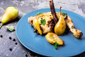 Chicken baked in pear sauce.