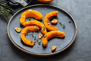 Cooked pumpkin pieces with garlic