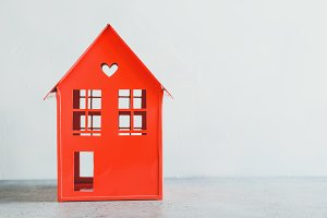 Metal red model of a house