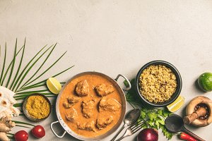 Traditional curry and ingredients on
