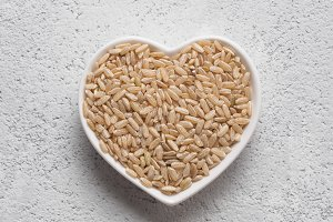 Brown rice in heart-shaped bowl
