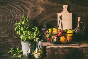 Colorful tomatoes , rustic kitchen