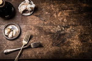 Rustic food background with cutlery