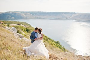 Pretty bride and groom kissing on th