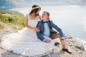 Stunning young wedding couple sittin