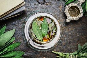 Herbal sage tea with fresh leaves