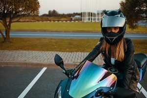 Blonde girl in protective helmet and