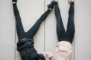 Two girls acrobats holding hands