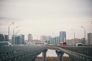 Cars go on bridge-roads on the