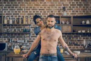 bearded shirtless man and his girlfr