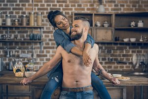 Bearded shirtless man and attractive