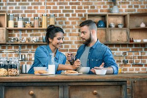 Happy young couple having breakfast