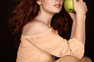 sensual redhead woman posing with gr