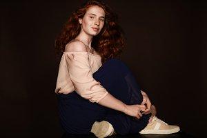 beautiful stylish redhead woman sitt
