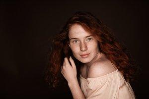 pretty sensual redhead woman posing