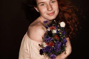 smiling elegant redhead girl holding
