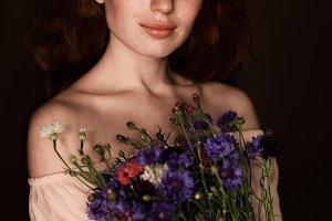 elegant tender redhead girl holding