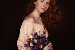 beautiful elegant redhead girl posin