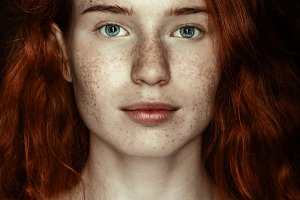 portrait of freckled redhead woman l