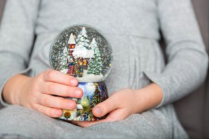 Christmas snowglobe in hands