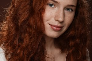 pretty redhead woman in white blouse